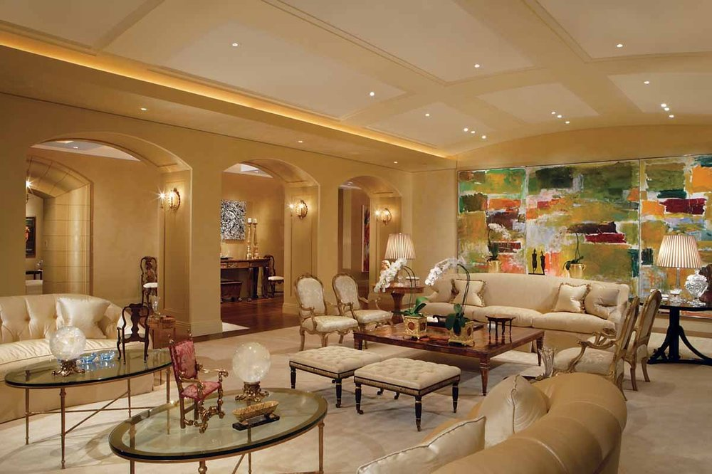 This formal living room has consistent beige tones on its ceiling, walls, arches and sofa set. Image courtesy of Toptenrealestatedeals.com.