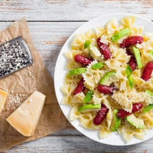 A plate of parmesan bow tie pasta salad.