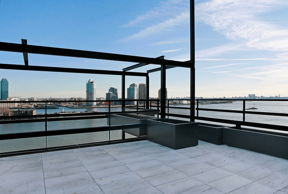 This is the look at the rooftop of the townhome showcasing the slender steel structure and the sweeping view of the New York skyline. Image courtesy of Toptenrealestatedeals.com.