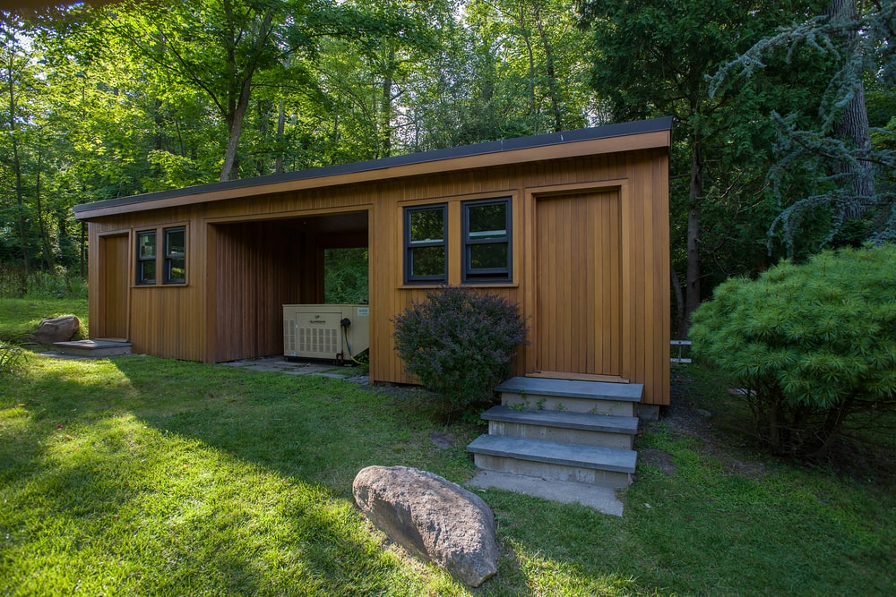 This is a look at the detached guest house with two small rooms that has separate entrances. In the middle of these two is a large power generator. Image courtesy of Toptenrealestatedeals.com.