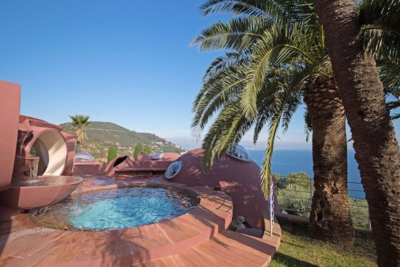 Another view of the home's stunning custom swimming pool. Image courtesy of Toptenrealestatedeals.com.