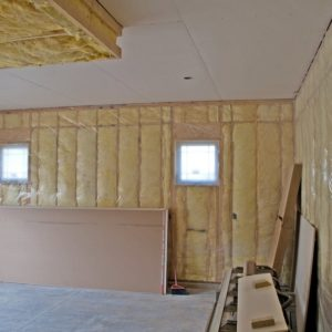 A look at a garage under construction with installed insulation.