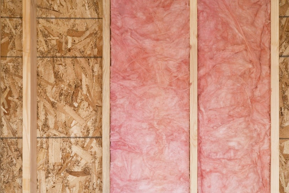 A close look at a wall installed with fiberglass insulation.