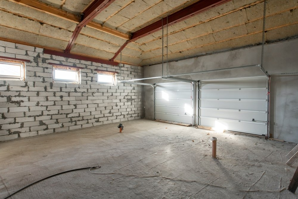 A look at a garage under construction with insulation installed.