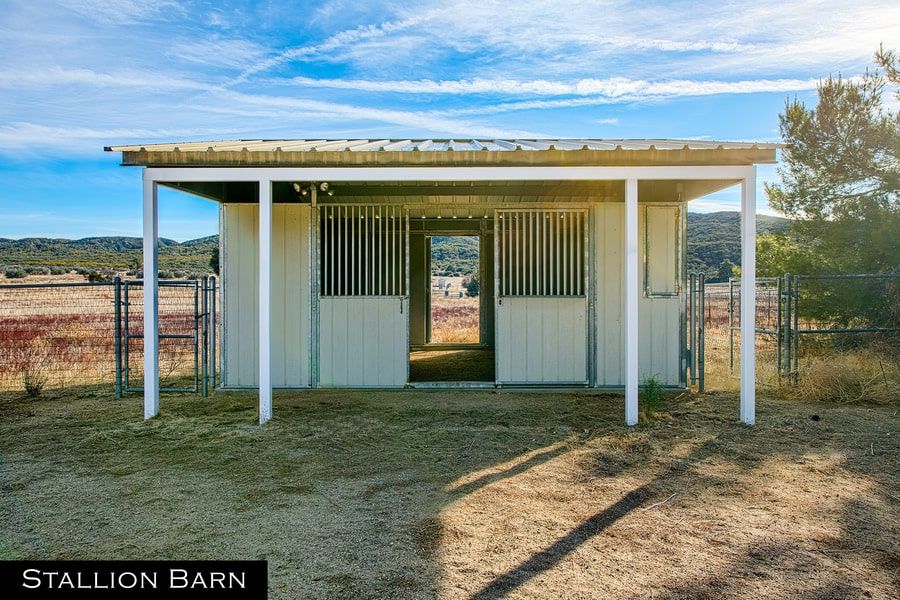 This is a look at the exterior of the stallion barn with bright tones on its walls and roof. Image courtesy of Toptenrealestatedeals.com.