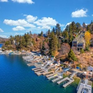 This is an aerial view of the house from the vantage of the lake. Here you can see it's elevation from the lake that is maximized by balconies and glass windows. Image courtesy of Toptenrealestatedeals.com.
