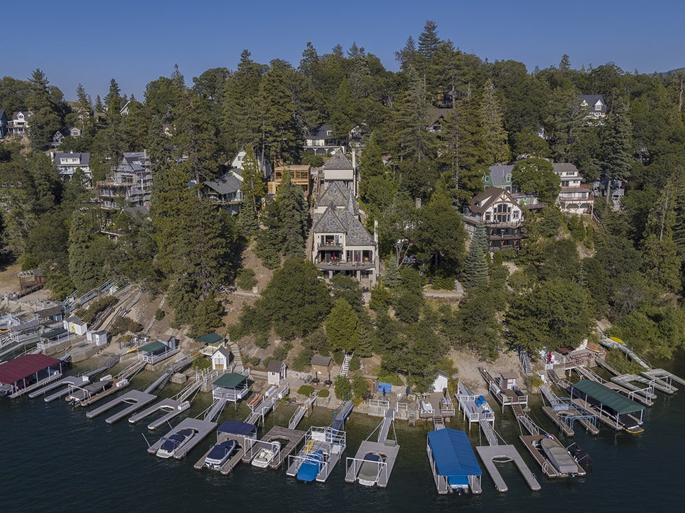This aerial view showcases the rows of boat docks just a few meters from the house. Image courtesy of Toptenrealestatedeals.com.