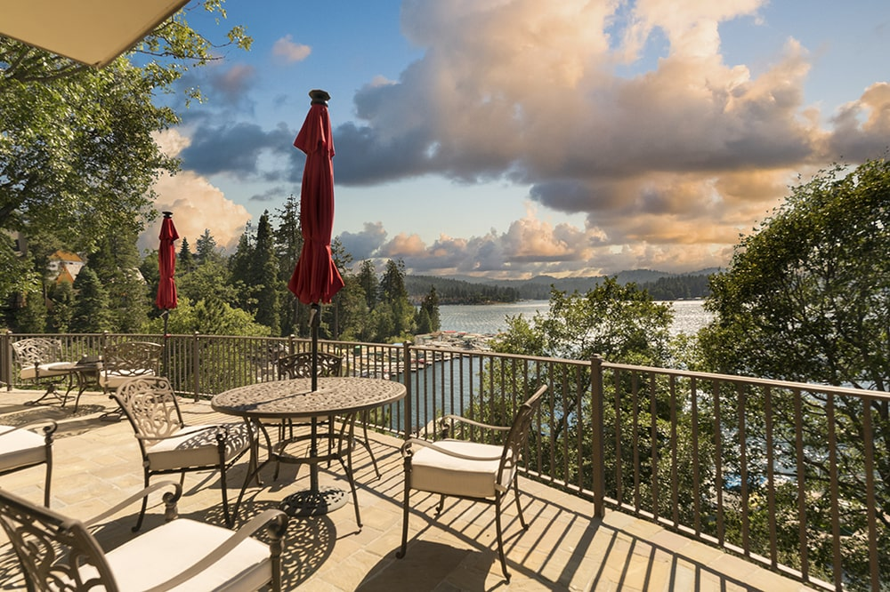This is a look at the views afforded by the balcony. This area if fitted with outdoor furniture topped with large umbrellas. Image courtesy of Toptenrealestatedeals.com.