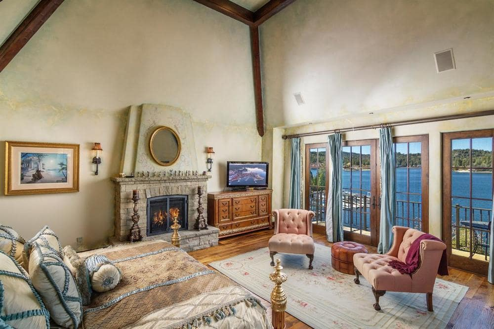 This angle of the bedroom shows the folding doors closed. On the side of this is a pair of cushioned chairs at the foot of the bed. Image courtesy of Toptenrealestatedeals.com.
