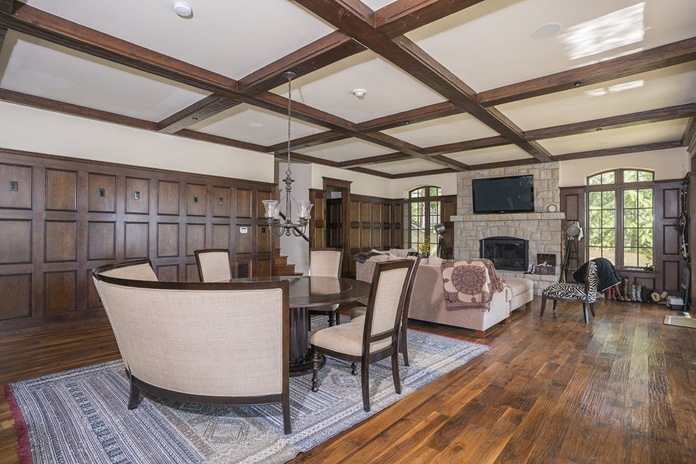 This other dining area has a dark wooden dining table paired with beige cushioned chairs. These pair well with the coffered ceiling the same color scheme. Image courtesy of Toptenrealestatedeals.com.