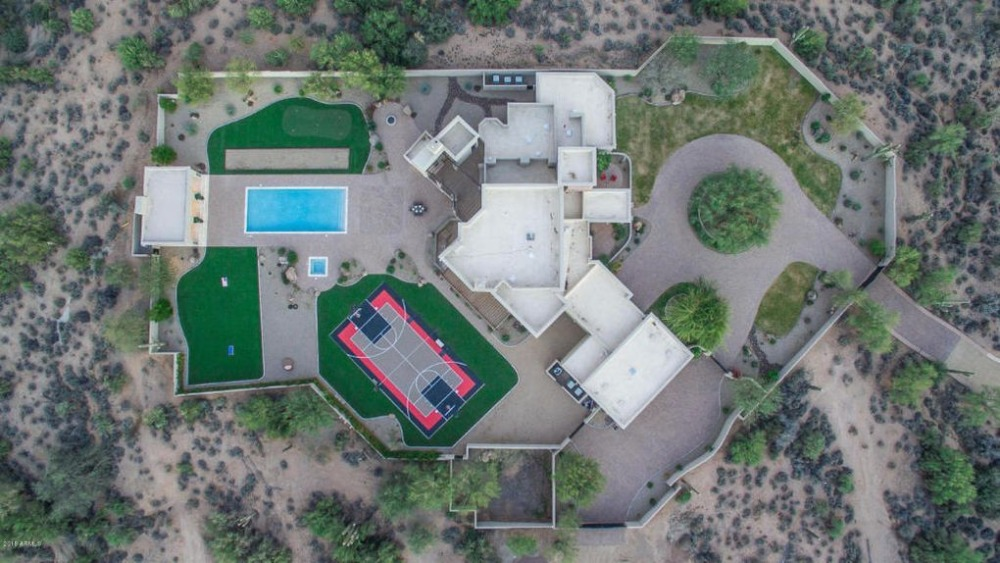 Bird's eye view of the property showcasing its exterior and overall outdoors. Image courtesy of Toptenrealestatedeals.com.