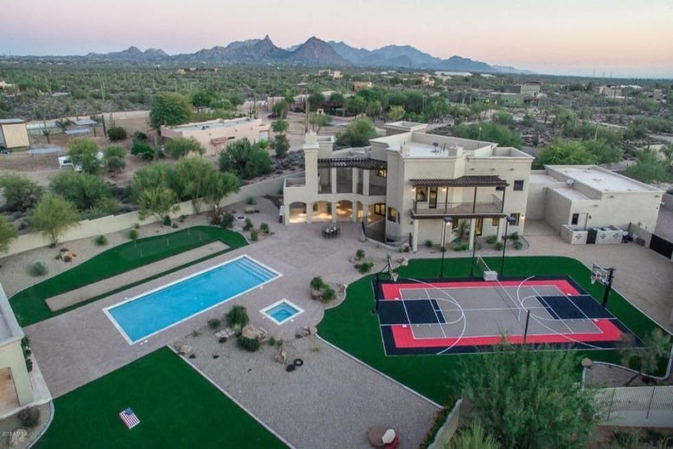 Aerial view of the property showcasing its outdoor amenities. Image courtesy of Toptenrealestatedeals.com.