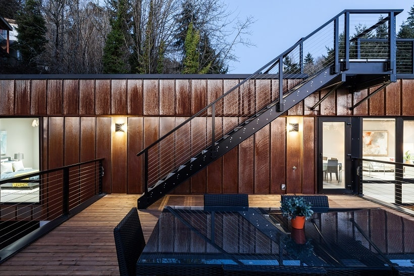 This look at the rooftop balcony shows a set of metal stairs that leads to a higher level rooftop area. Image courtesy of Toptenrealestatedeals.com.