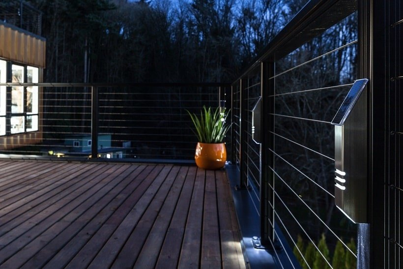This is a close look at the modern steel railings of the rooftop balcony adorned with a potted plant on the corner. Image courtesy of Toptenrealestatedeals.com.