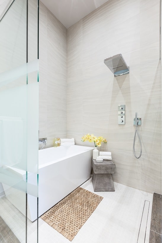 This is a close look at the bathroom's shower area through the glass doors. On the side of this is a bathtub. Image courtesy of Toptenrealestatedeals.com.