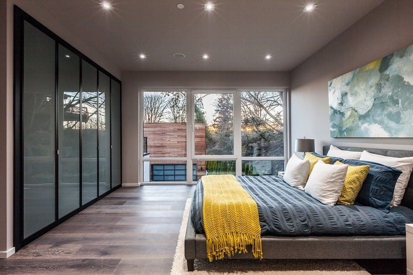 This other view of the bedroom shows the frosted glass built-in cabinetry across from the bed. Image courtesy of Toptenrealestatedeals.com.