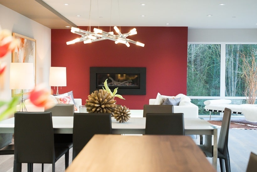 This is a look at the dining area from the vantage of the kitchen island. This has a white rectangular modern dining table contrasted by the black chairs. Image courtesy of Toptenrealestatedeals.com.