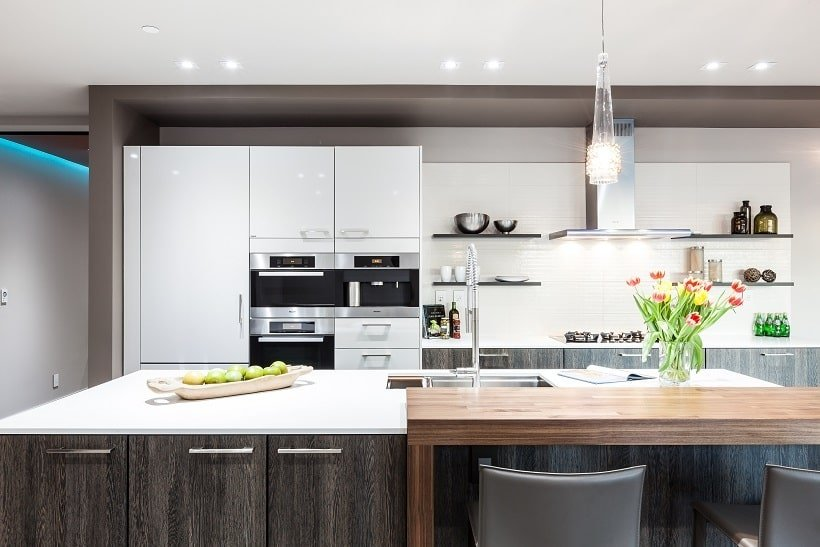 This is a closer look at the kitchen island that has a white countertop to contrast the dark tone of the cabinetry. Image courtesy of Toptenrealestatedeals.com.