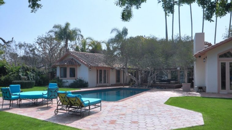 This is a look at the back of the house. Here you can see the swimming pool surrounded by brick walkways and on the far side of it is the patio in the middle of the U-shaped house. Image courtesy of Toptenrealestatedeals.com.