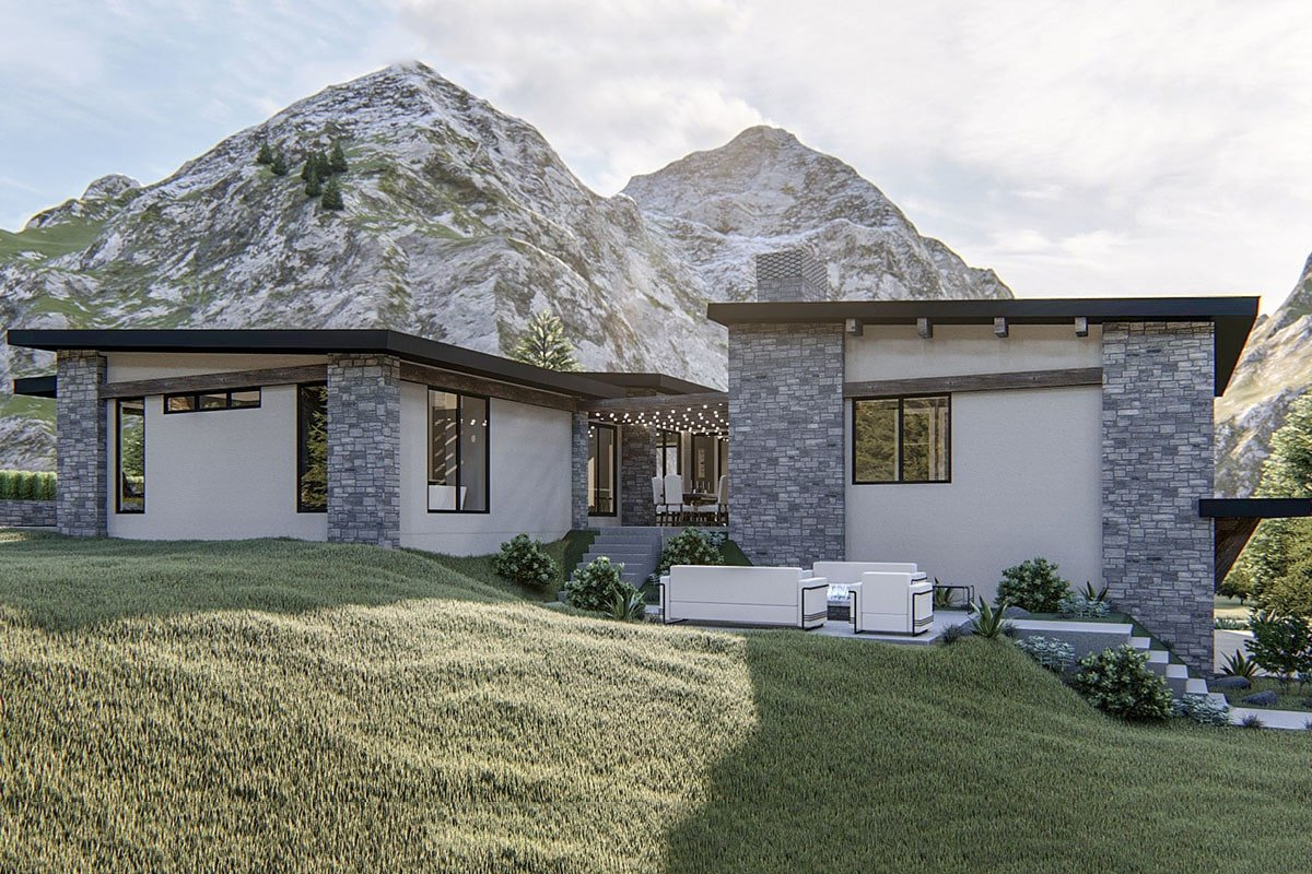 Right side view with a courtyard and an open patio against the magnificent mountain backdrop.