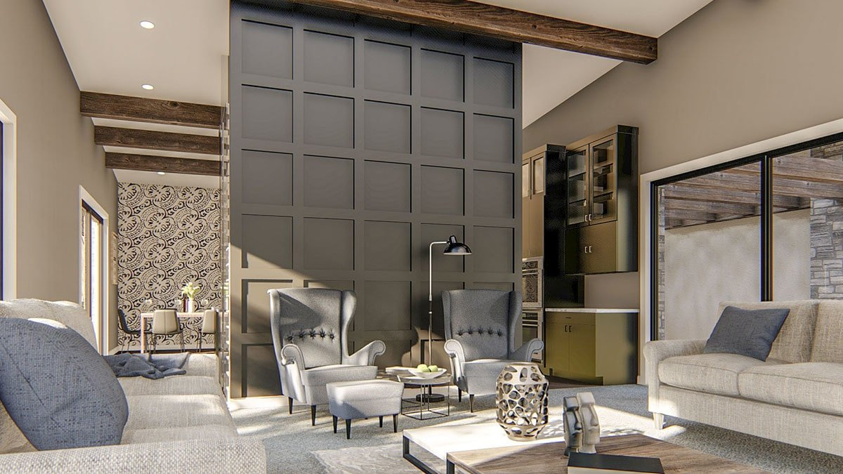 Gray wingback chairs against the paneled wall complete the living room.