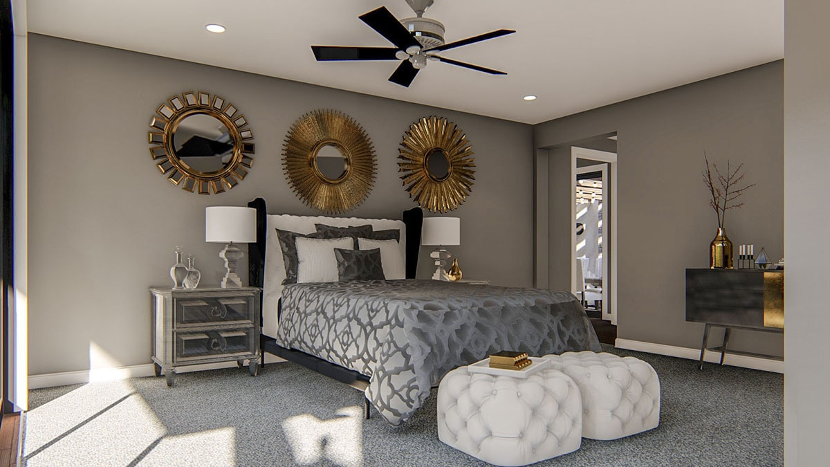 The primary bedroom is furnished with a sleek console table, tufted ottomans, carved wood nightstands, and a wingback bed adorned with gold sunburst mirrors.