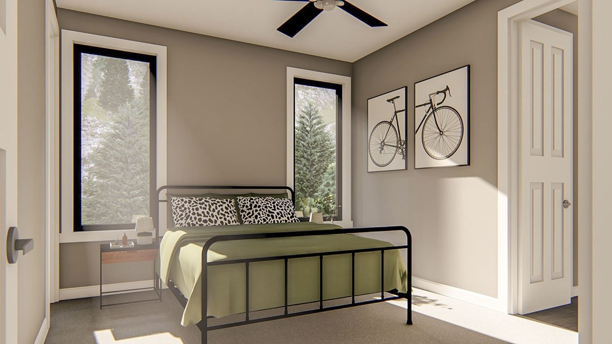 Another bedroom with carpet flooring, metal furnishings, and multi-panel artwork mounted on the gray wall.Another bedroom with carpet flooring, metal furnishings, and multi-panel artwork mounted on the gray wall.