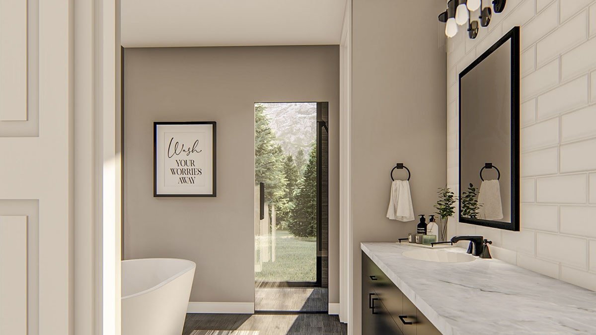The primary bathroom offers a freestanding tub and a black vanity with white marble countertop and wrought iron fixtures.