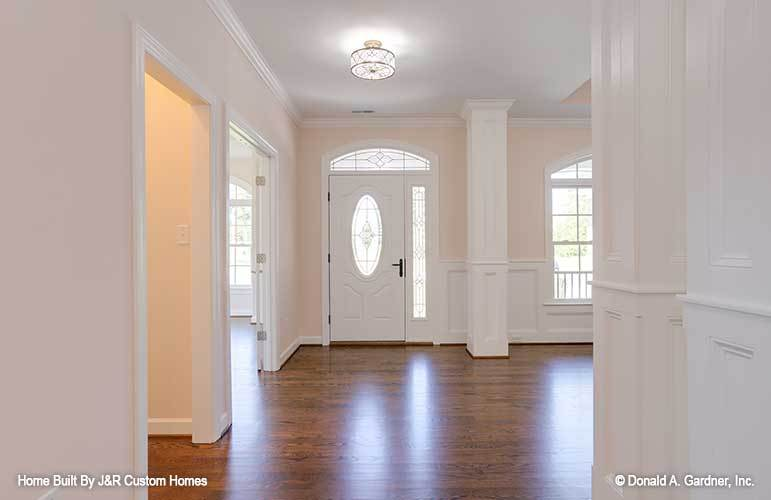 The foyer has a semi-flush light and a white front door fitted with stained glass panels.