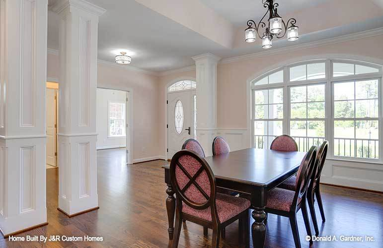 Across the dining area are the foyer and a spare bedroom that doubles as a study.