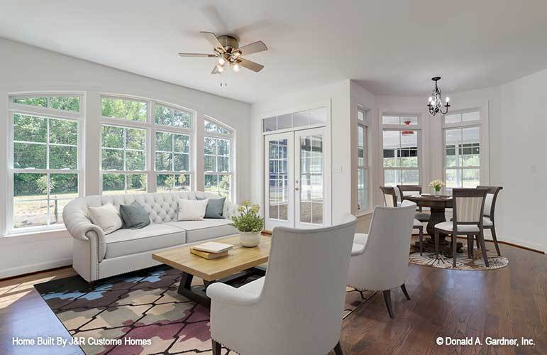 Morning room and breakfast nook with natural hardwood flooring, white-framed windows, and a french door that leads out to the back porch.