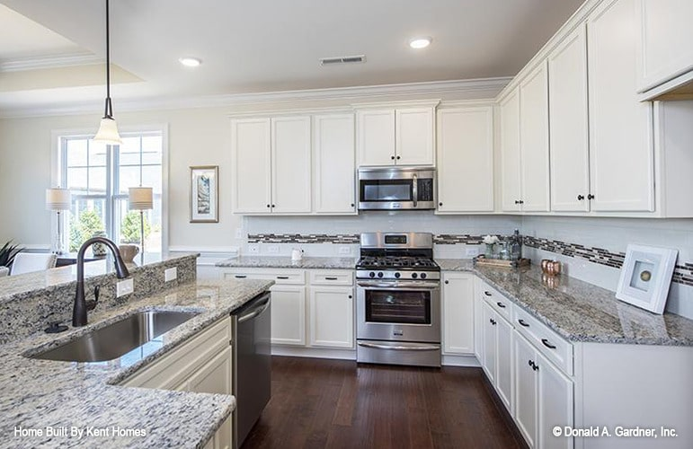 Stainless steel appliances and an undermount sink fitted in the granite top island complete the kitchen.
