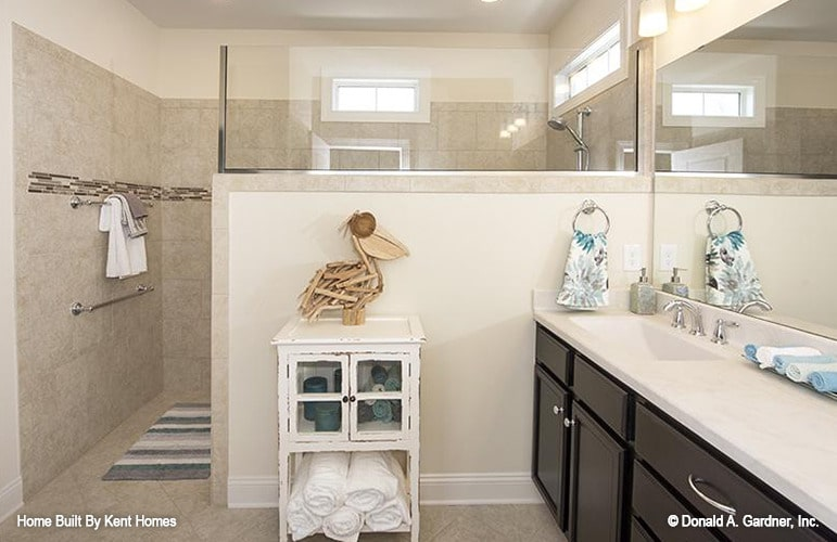 The primary bathroom is equipped with a sink vanity, linen cabinet, and a walk-in shower.