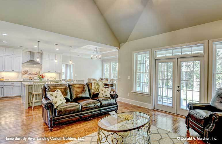 A white french door on the side opens out to the rear porch.