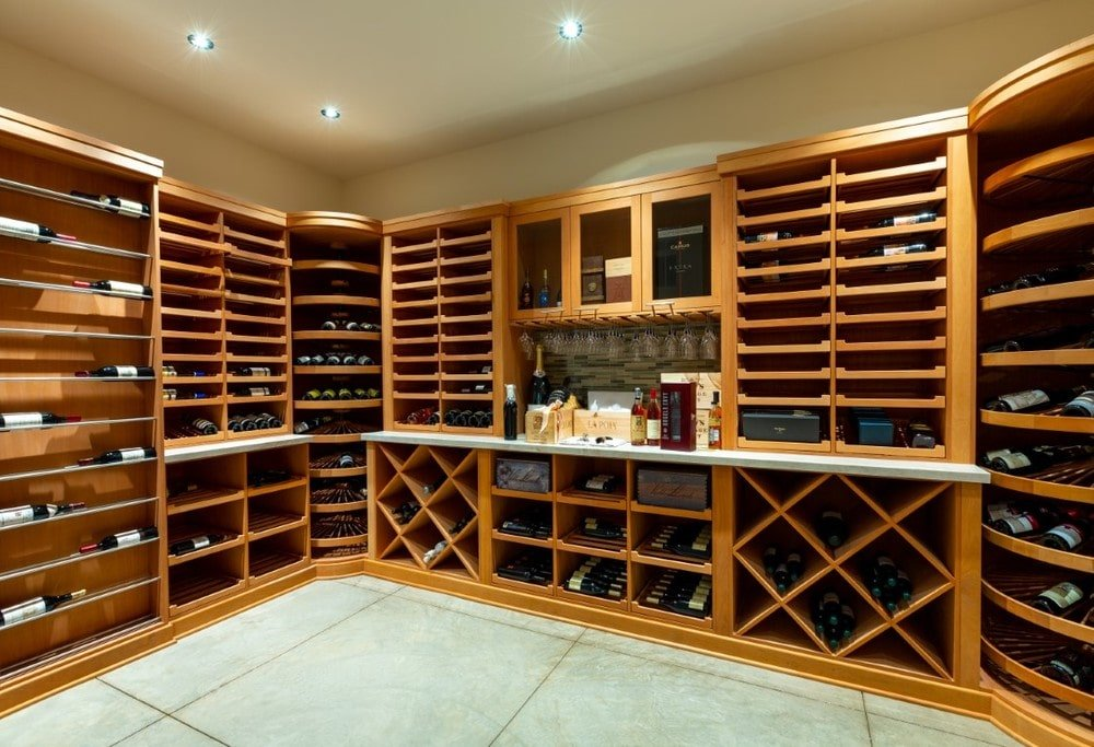 This is the large wine cellar with large wooden structures lining the walls for wine storage. Image courtesy of Toptenrealestatedeals.com.