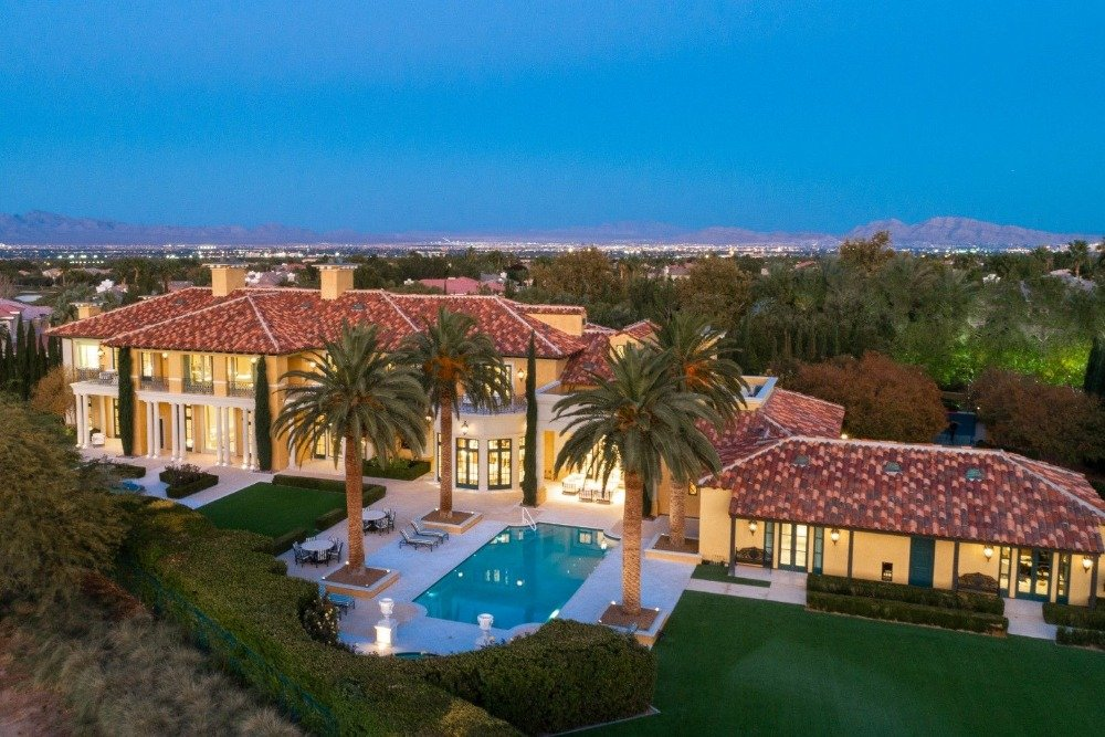 Aerial view of the house's rear exterior, taken at night. Image courtesy of Toptenrealestatedeals.com.