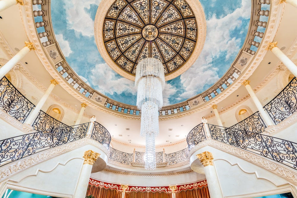 This is a close look at the intricate design of the tall foyer ceiling that also hangs a large crystal chandelier over the middle of the floor. Image courtesy of Toptenrealestatedeals.com.