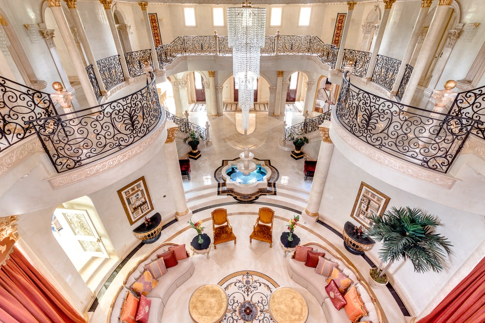 This is a look at the living room below from the vantage of the indoor balcony. Here you can see the intricate wrought-iron railings and the circular living room below. Image courtesy of Toptenrealestatedeals.com.