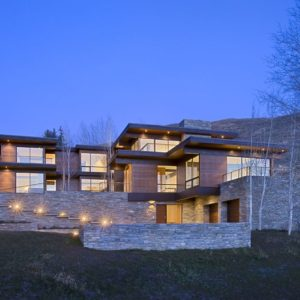 This is the front view of the house. You can see here that it has three levels of contemporary wood and glass exteriors. These are then complemented by the warm lights of the exterior and interior. Image courtesy of Toptenrealestatedeals.com.