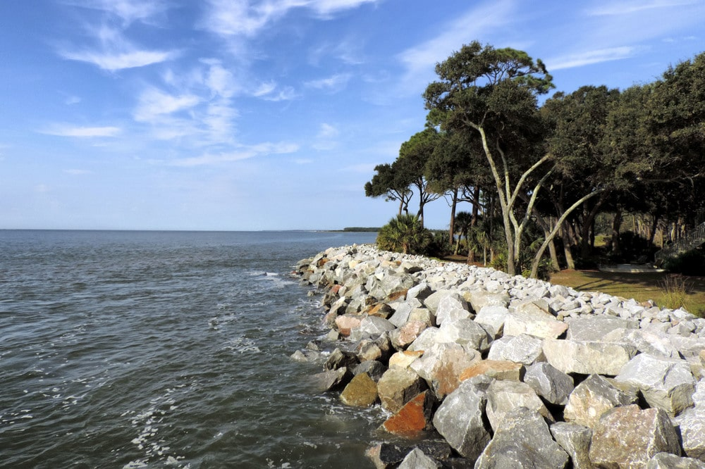 This is the tide breaker of the island filled with large rocks to lessen tide erosion. Image courtesy of Toptenrealestatedeals.com.