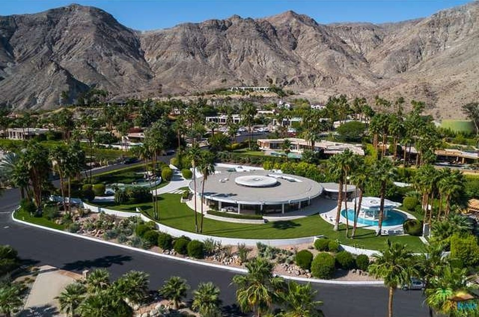 This is an aerial view of the house showcasing the various structures and outdoor areas complemented by the landscape. Image courtesy of Toptenrealestatedeals.com.