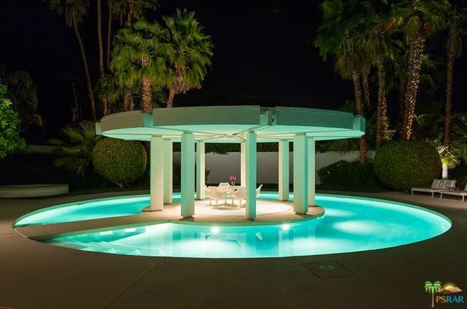 This is a close look at the circular covered island in the middle of the round moat-style swimming pool that glows with its own lighting. Image courtesy of Toptenrealestatedeals.com.