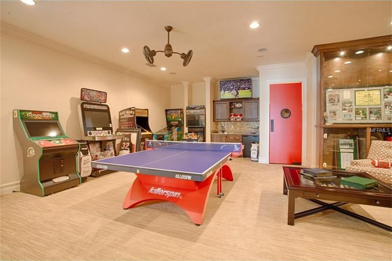 The game area has a large space filled with various arcade games and a large ping pong table in the middle. Image courtesy of Toptenrealestatedeals.com.