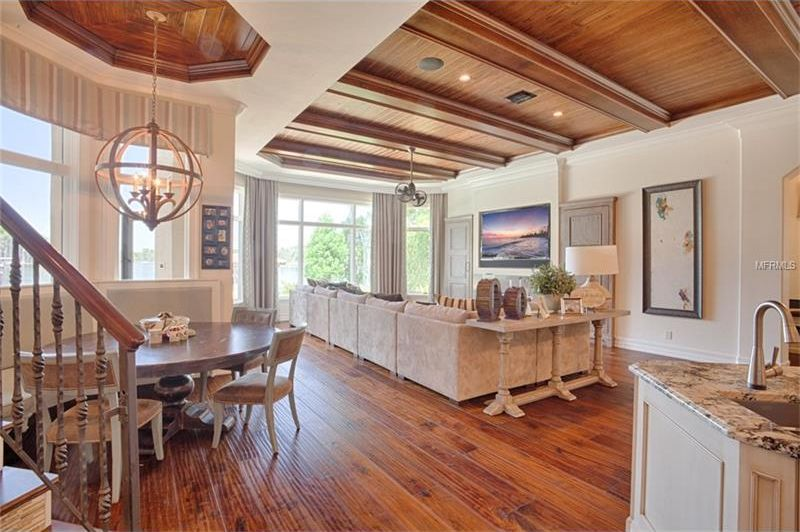 This is the great room with a living room area on the far corner and an informal dining area just a few steps from the kitchen. Image courtesy of Toptenrealestatedeals.com.