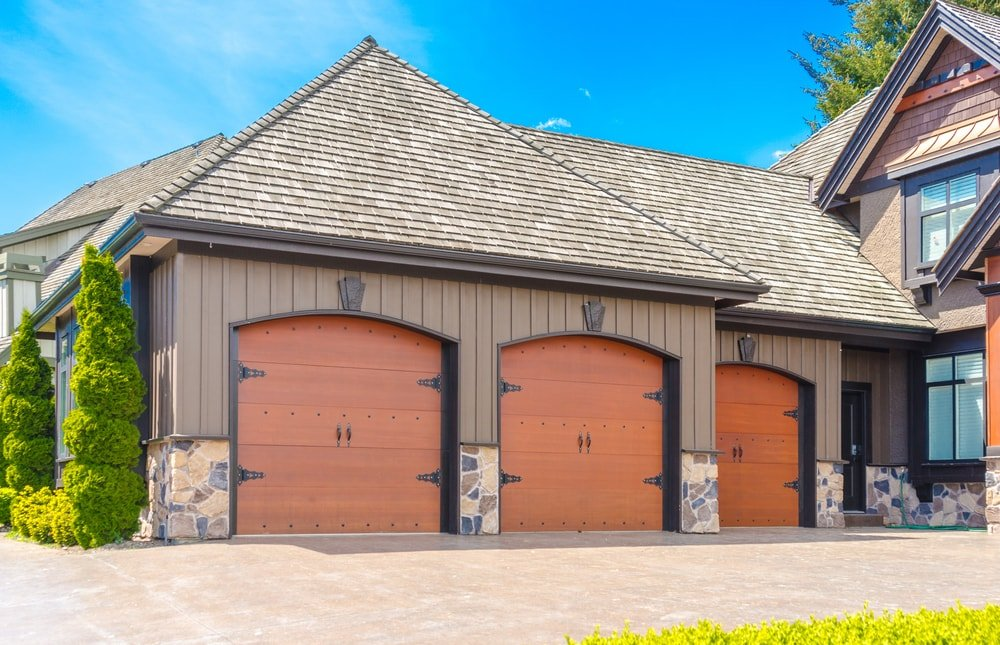 House exterior with a triple car garage.