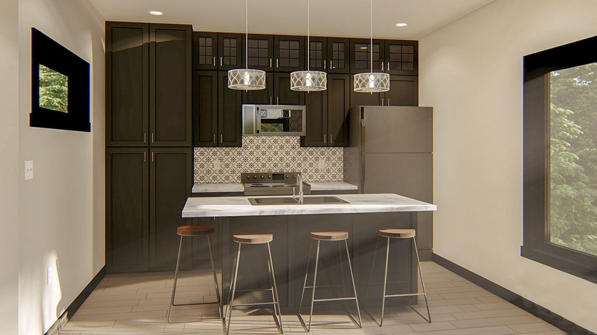The kitchen is equipped with slate appliances, dark wood cabinets, and a breakfast bar well-lit by drum pendants.