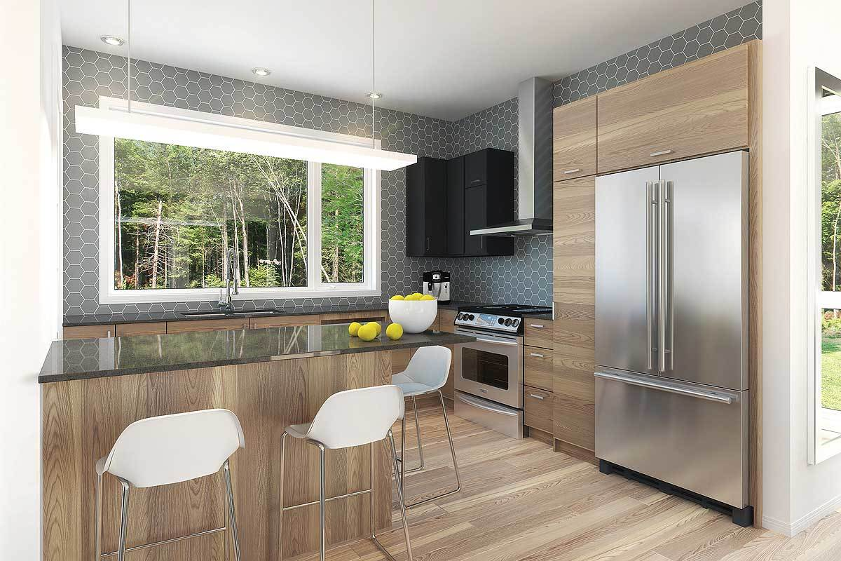 The kitchen is equipped with stainless steel appliances, wooden cabinetry, a peninsula, and black overhang cabinets fixed against the hex tile backsplash.