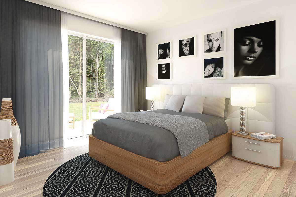 The primary bedroom has wooden furnishings, contemporary decors, a gallery wall, and a round area rug that lays on the light hardwood floor.