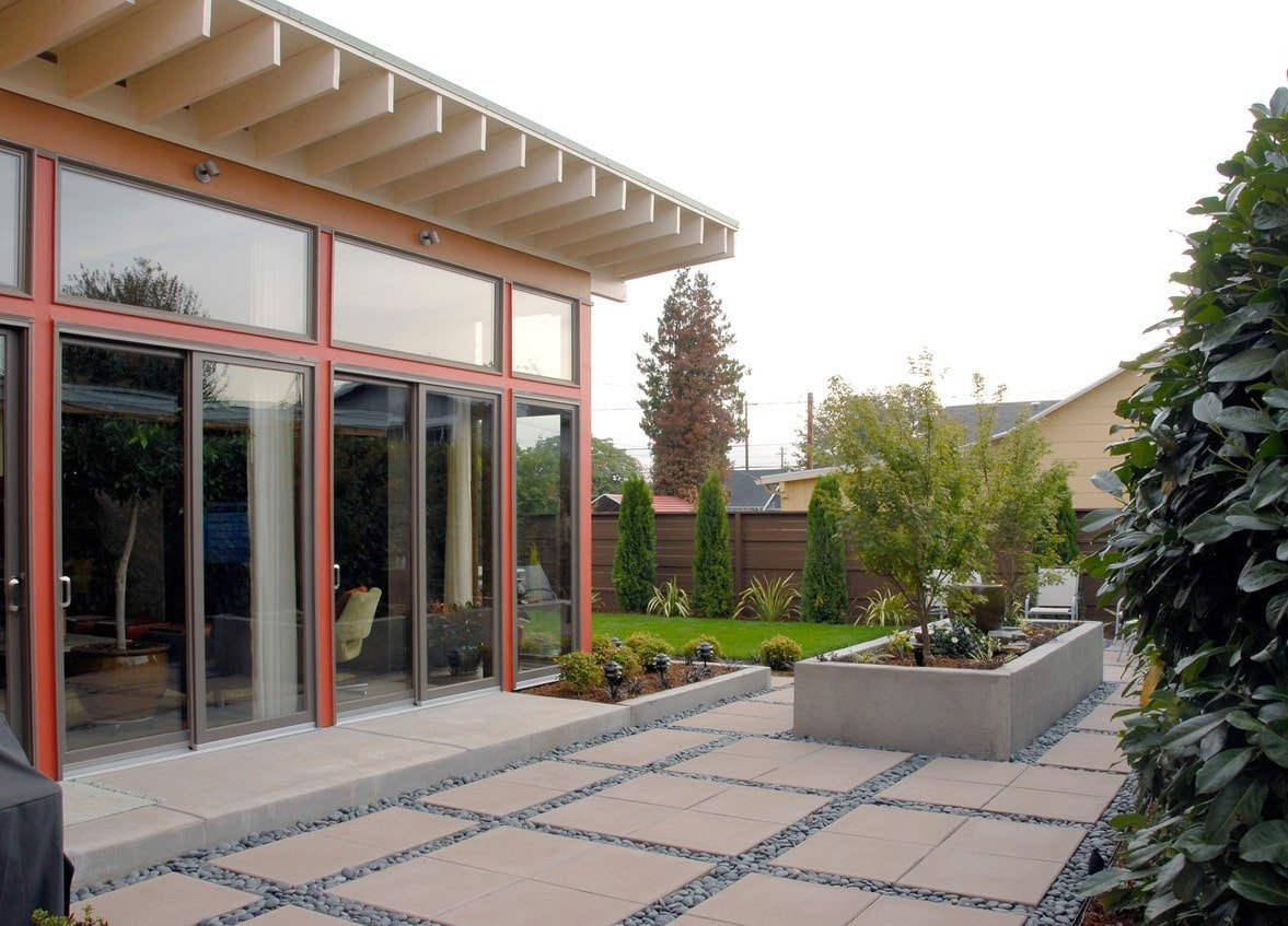 The opposite side view shows the glass sliding doors that open to the home's living room.