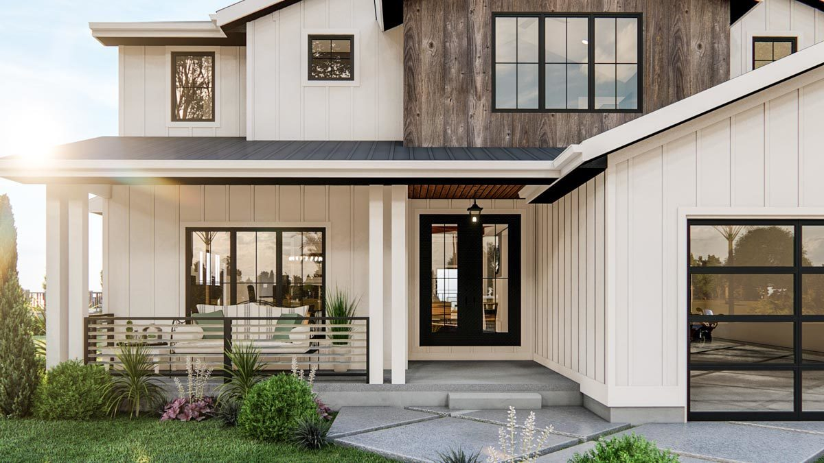 Covered front porch with double columns, white sofa, and a french entry door.